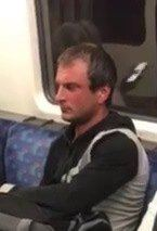 Image of man police wish to speak to about assault on Central Line train